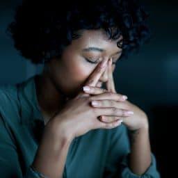 Woman experiencing sinus pressure and allergies.