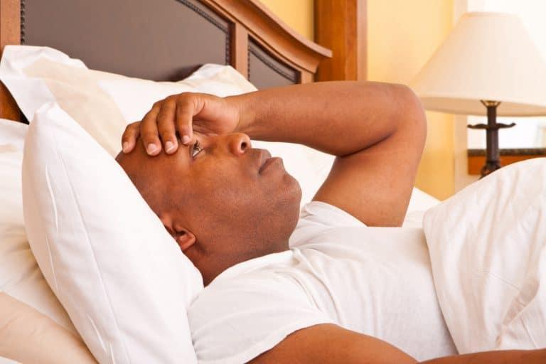 Man struggling to sleep.