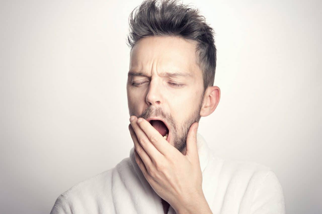 Close up of man yawning.