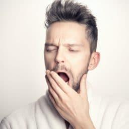 Close up of man yawning